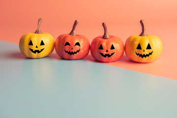 Halloween concept, Four Pumpkin with smile face on pastel colors background.