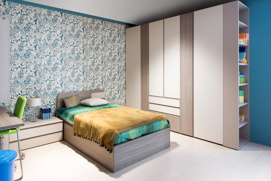 Blue and green themed bedroom interior