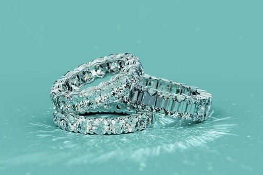 Tree diamond eternity rings on turquoise background
