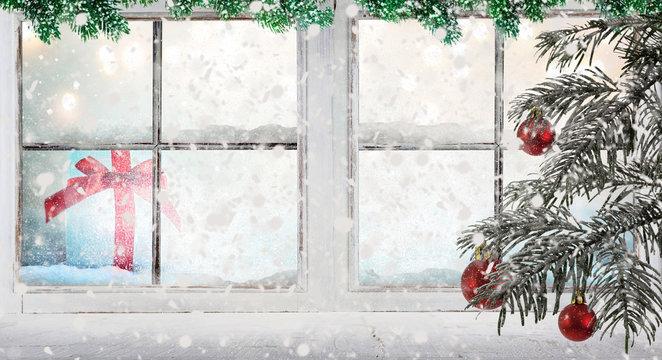 Stimmungsvolles Weihnachtsfenster mit Schneefall und Tanne