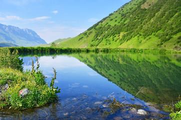 Russia, North Ossetia. Midagrabin (Midagrabinskoe) lake in the mountains in summer