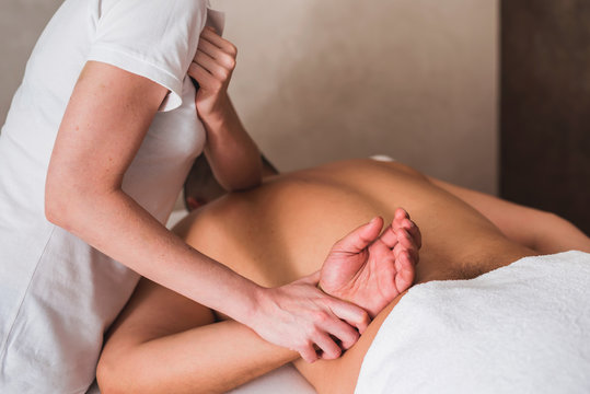 Man enjoying sports massage at spa