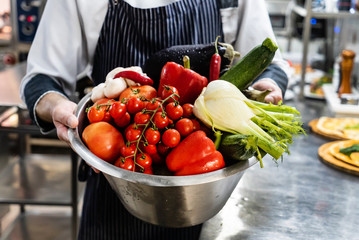 chef with fresh organic vegetables