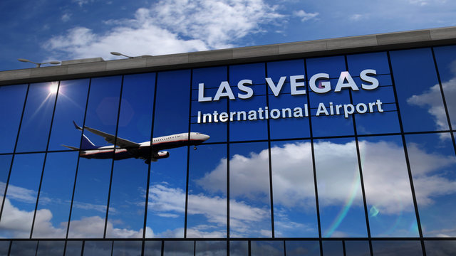 Airplane landing at Las Vegas Nevada mirrored in terminal