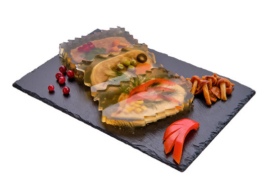 Variety of jellied meatloaf served with mushrooms and cranberry