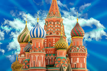 Fototapete - Fragment view of Saint Basil's Cathedral at Red Square in Moscow, Russia, on a cloud sky background with light rays.