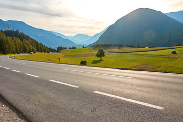 Mountain road in Germany, between green fields and mountain landscapes