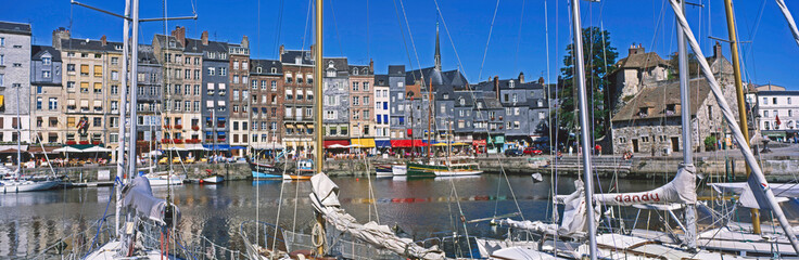 The picturesque inner harbour at the Normandy port of Honfleur in the north of France Fototapete