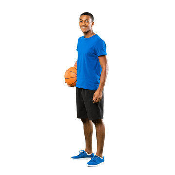 Full-length shot of Afro American basketball player man over isolated white background