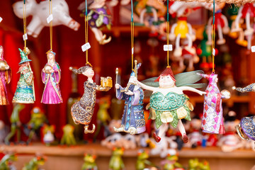 Fairytale character Christmas baubles for sale at Christmas market stall in Berlin Germany