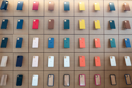 AVENTURA, FLORIDA, USA - SEPTEMBER 20, 2019: Apple iphone 11 series protection cases hanging on the wall in Apple store in Aventura Mall