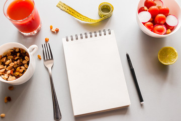 notepad with place for text and vegetables concept healthy eating calorie counting