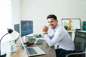 Happy Attractive Young Stock Broker Working At Home - fototapety na wymiar