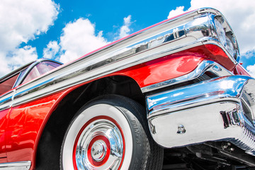 Profile of a red 1958 Oldsmobile Super 88.