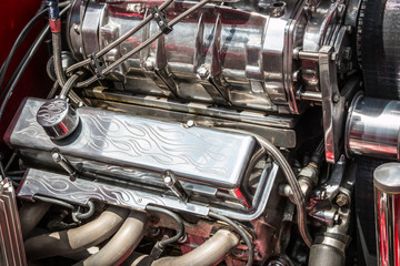 Souped up super-charged hot rod engine with chrome flames.