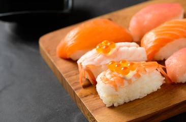 Foto op Plexiglas Sushi bar Ikura (salmon roe) on prawn sushi and sashimi sushi set