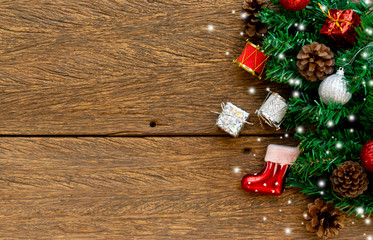 close up top view of decorated pine branches tree with group of objects and falling snow  on vintage wood background texture for party celebration of merry christmas festival tonight concept