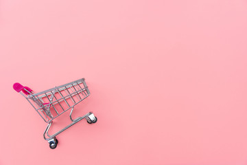 Empty shopping cart on pink background. Shopping, shopping online concept.,copy space, top view