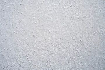 Rough bumpy white or gray stucco or concrete - background or texture