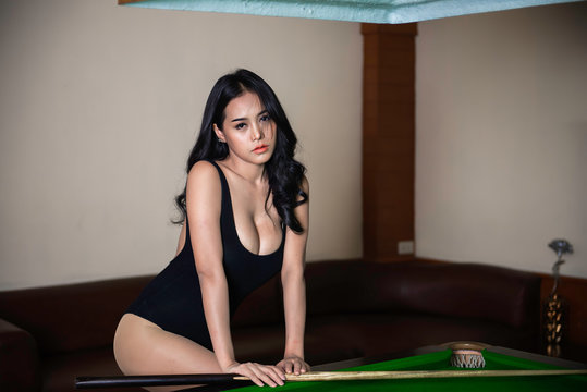 Portrait of asian sexy woman wear black one piece at snooker club,Beautiful Thailand people pose for take a picture