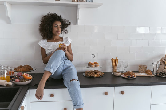 Young woman being deep in thought during breakfast