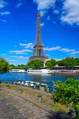 Wall Mural - Paris Eiffel Tower and river Seine in Paris, France. Eiffel Tower is one of the most iconic landmarks of Paris. Cityscape of Paris