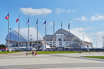 "Sochi, Russia, August, 10, 2019. People walking near Olympic stadium ""Fisht"" in Sochi (Adler) in August in Sunny weather"