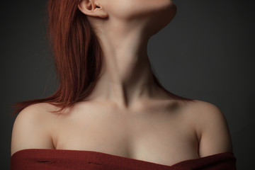Portrait of young woman with bare shoulders.