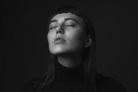 Portrait of a woman with closed eyes. Black and white