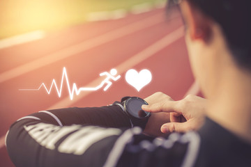 Women measuring heart rate with a watch after running