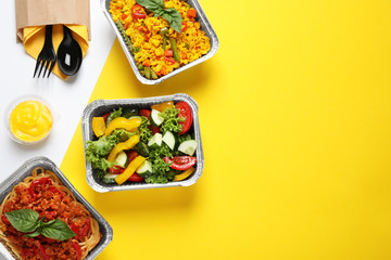 Aluminium Prints Food Lunchboxes on color table, flat lay. Healthy food delivery