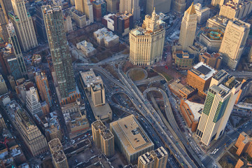 Top down aerial view of New York City  Brooklyn bridge infrastructure between the highrise modern office buildings