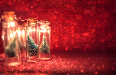 Fototapete - Close-up, Elegant Christmas tree in glass jar with glitter background. copy space.