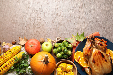 Flat lay composition with delicious turkey on wooden background, space for text. Happy Thanksgiving...