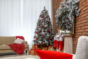 Stylish interior with beautiful Christmas tree and decorative fireplace