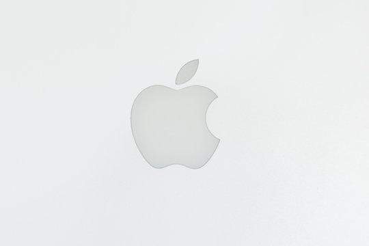 Black Apple logo on brushed aluminium background
