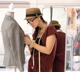Small business - fashion designer woman working