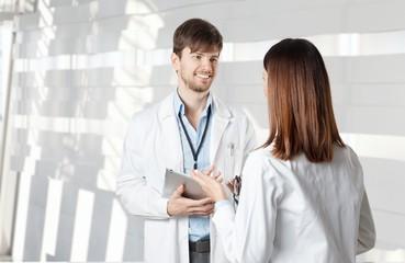 Doctors talking on hospital corridor