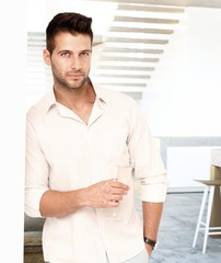 Portrait of young man drinking champagne