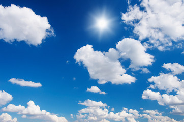 Wall Mural - White clouds in blue sky.