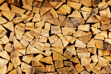 Tuinposter Brandhout textuur Woodpile in stack.Triangle shape. Wall of firewood