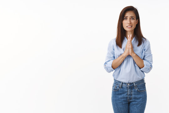 Woman feel need, begging for help, badly plead advice, say please, hold hands pray, supplicating, apologizing making huge mistake, frowning upset, clench teeth, asking favor, white background