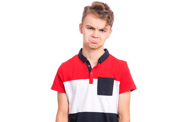 Fototapete - Upset handsome caucasian Teen Boy, isolated on white background. Teenager looking at camera. Unhappy child - close-up portrait.
