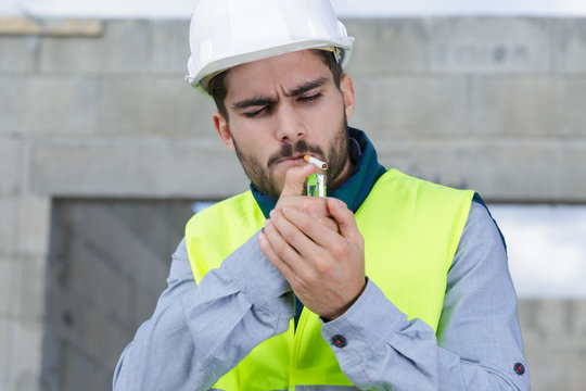smoking cigarette at construction site