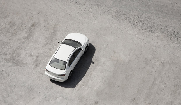 white car parked in the sand. aerial view