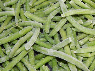 Closeup of frozen green beans with ice crystals, kitchen-ready for cooking