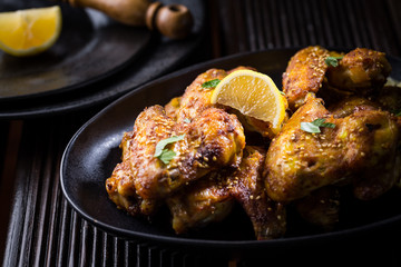 Spicy chicken wings with garlic and lemon marinade