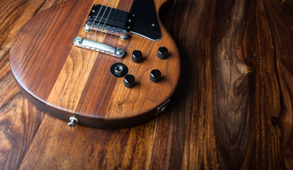 Electric guitar on wood background