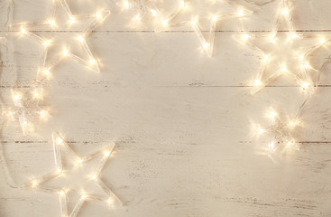 Beautiful glowing garland on white wooden background