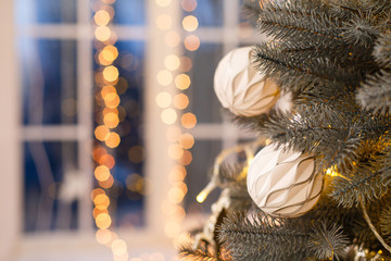 Christmas tree background. New Year composition with spruce and lights. Close up image of christmass tree